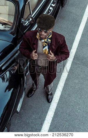African American Man Posing With Car