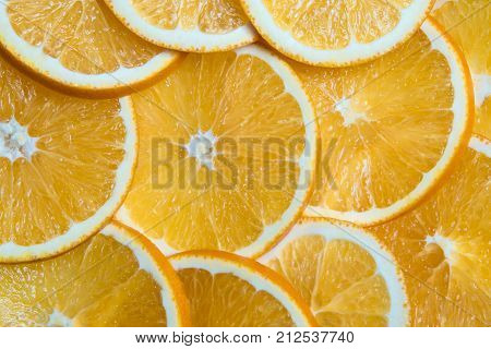 Horizontal shot of sliced oranges background bright fresh fruit cut into even slices