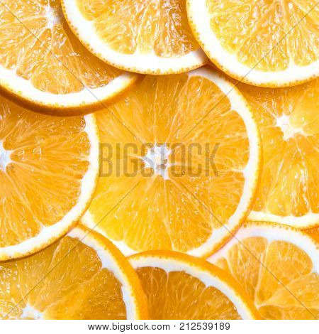 Square shot of sliced oranges background bright fresh fruit cut into even slices