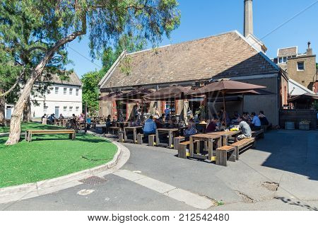 Melbourne, Australia - February 7, 2016: outdoor dining at one the food businesses at Abbotsford Convent in inner urban Melbourne.