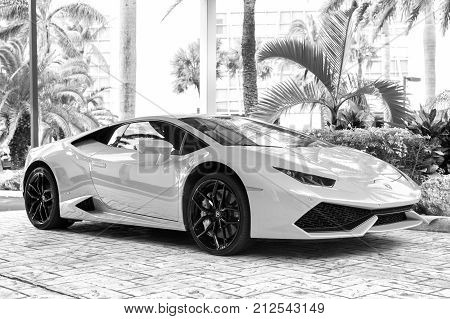 Miami Florida USA-February 19 2016: Supercar Lamborghini Aventador orange color parked next to Ocean drive at South bech at Miami Florida. Lamborghini is famous expensive automobile brand car