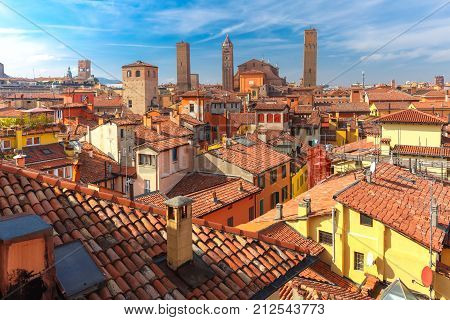 Aerial view of Bologna Cathedral and towers towering above of the roofs of Old Town in medieval city Bologna in the sunny day, Emilia-Romagna, Italy