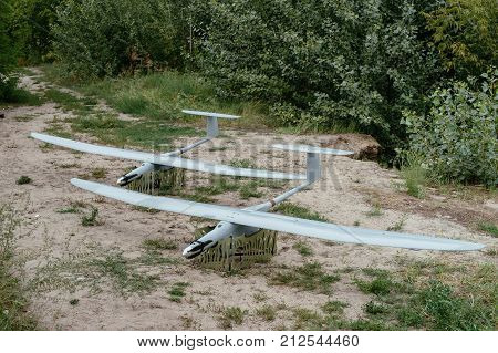 Preparing the army drones for the mission. A pair of reconnaissance aircraft in the wild