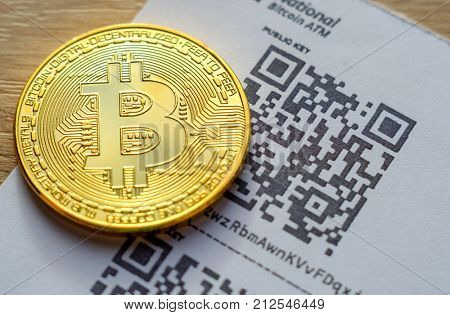 Bitcoin golden coins and paper ATM receipt macro