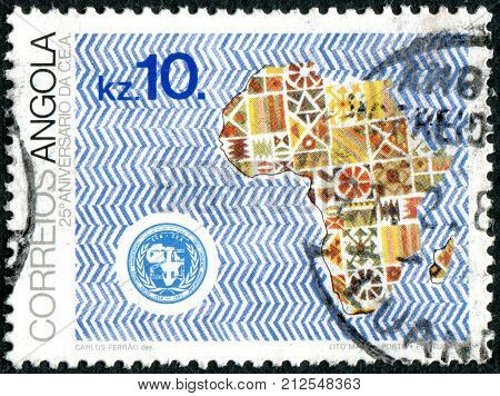 ANGOLA - CIRCA 1983: A stamp printed in Angola dedicated to 25th Anniversary of Economic Commission for Africa shows the emblem and map of Africa circa 1983