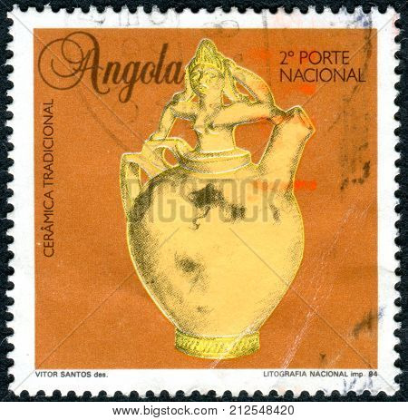 ANGOLA - CIRCA 1995: A stamp printed in Angola shows the traditional ceramics of Lovale people pitcher with bust of a woman as stopper circa 1995