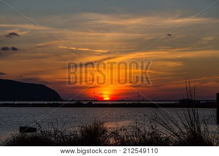 Sunset At Lefkas Lagoon In Greece With Dike And Water