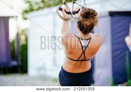 Women Workout Arms With Trx Fitness Belts In Nature Makes A Push Up The Upper Body Trailer Chest Sho