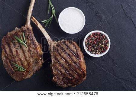 Grilled tomahawk steak beef . With rosemary