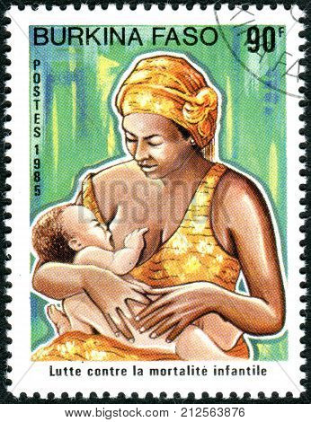 BURKINA FASO - CIRCA 1986: A stamp printed in Burkina Faso dedicated to Fight against infant mortality shows Mother with her child circa 1986