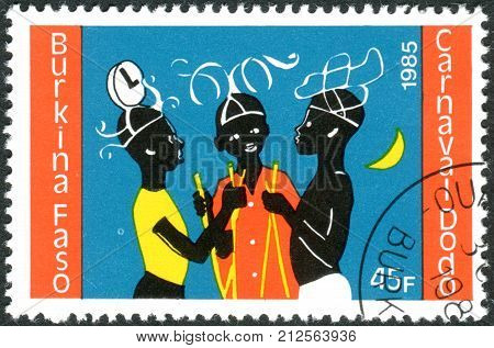 BURKINA FASO - CIRCA 1986: A stamp printed in Burkina Faso dedicated to Dodo Carnival shows three young dancers circa 1986