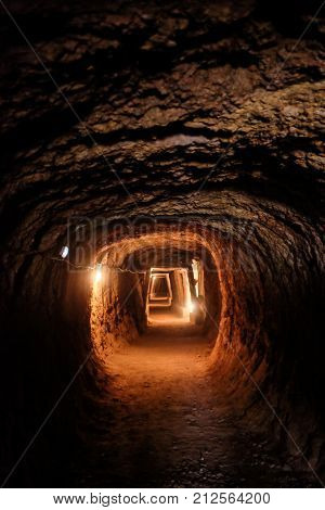 Long and illuminated tunnel in a deactivated mine