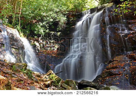 water falls cascading down a rocky cliff