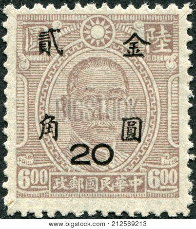 CHINA - CIRCA 1945: A stamp printed in China (Taiwan) shows a Chinese revolutionary and first president and founding father of the Republic of China Sun Yat-sen (overprint 1948) circa 1945