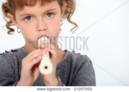 little girl playing flute