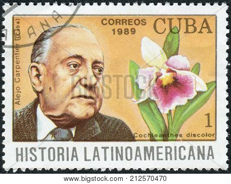 CUBA - CIRCA 1989: Postage stamp printed in Cuba shows Cuban writer Alejo Carpentier and orchid Cochleanthes discolor circa 1989