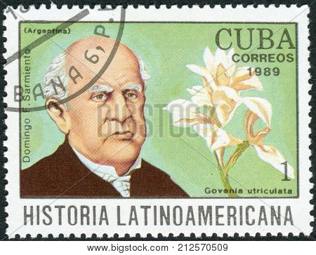 CUBA - CIRCA 1989: Postage stamp printed in Cuba shows the Argentine writer and 7th President of Argentina Domingo Faustino Sarmiento and orchid Govenia utriculata circa 1989