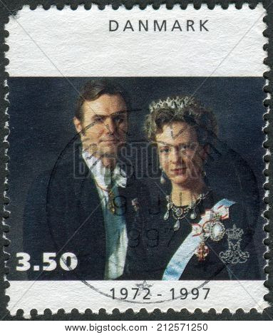 DENMARK - CIRCA 1997: Postage stamp printed in Denmark dedicated to the 25th anniversary of coronation Queen Margrethe II shows Queen Margrethe II with Prince Henrik