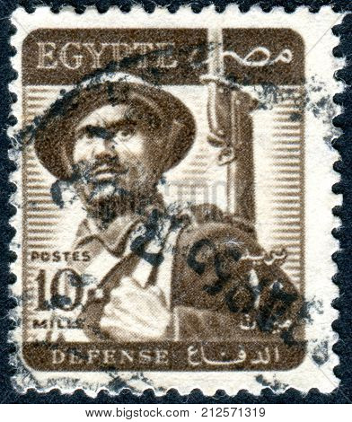 EGYPT - CIRCA 1953: A stamp printed in Egypt shows a soldier circa 1953