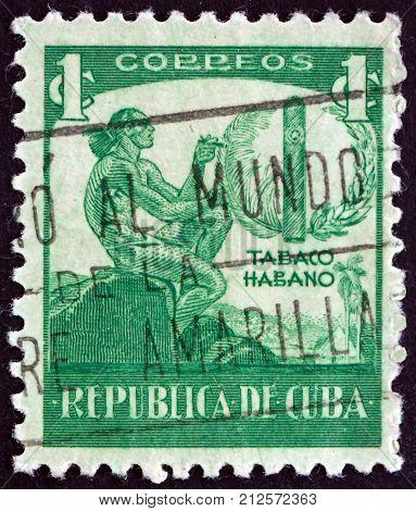 CUBA - CIRCA 1956: a stamp printed in the Cuba shows Ciboney Indian and cigar circa 1956