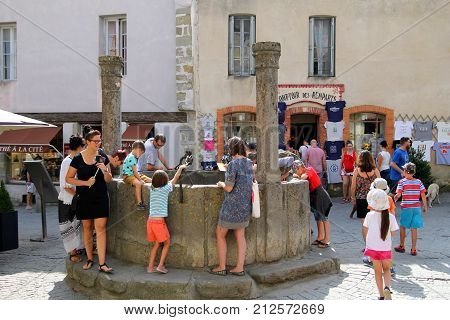 Carcassonne, Languedoc-roussillon, France - August 24 2017: Children And Other Tourists Looking Down