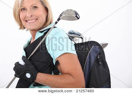 elderly woman liking golf