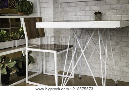 Room ambiance with white metal table and chair stock photo