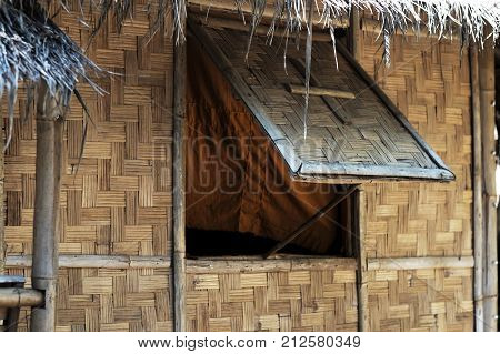 traditional vintage bamboo house in northern of thailand. Open the window because of the heat and stuffiness, to ventilate the house