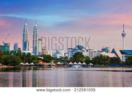 KUALA LUMPUR, MALAYSIA - JUNE 19, 2011: Kuala Lumpur skyline with Petronas Twin Towers skyscrapers on sunset. View over Titiwangsa Lake. Kuala Lumpur, Malaysia
