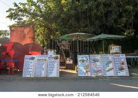 Vang Vieng, Laos - January 19, 2017: Small outdoor cafe in Vang Vieng, Laos
