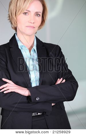 Unimpressed woman with her arms folded poster
