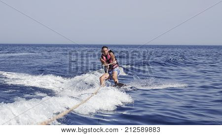 Man Wakeboarder At Sea In Summer