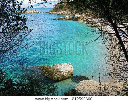 kassiopi blue lagoon beach coast in the ionian sea landscape on Corfu island