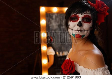 Photo of witch girl with bodypainting on her face