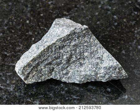 Raw Olivinite Stone On Dark Background