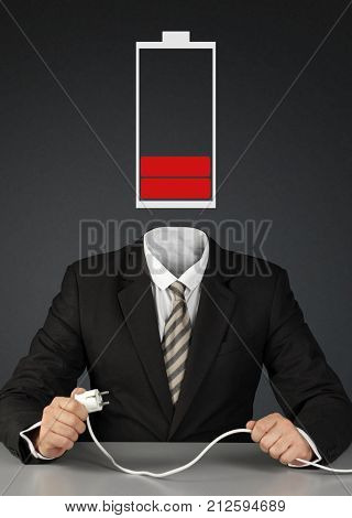 man with battery head and plug charge you mind concept