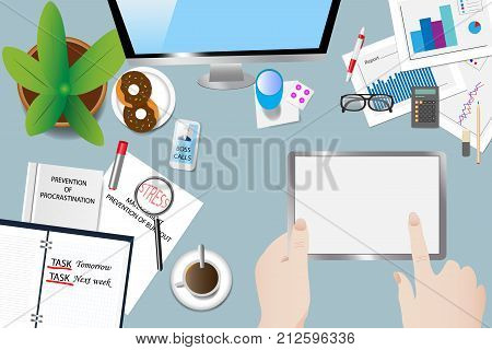 Top view of the office desk with objects book of procrastination open diary and ringing phone. Hands holding the tablet point to a blank screen ready for your text.