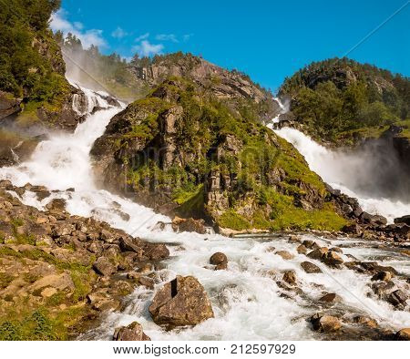 Summer Latefossen twin waterfall in Odda Norway