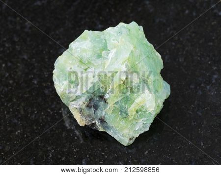Rough Crystal Of Chrysopal Gemstone On Dark