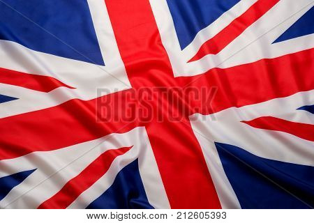 Closeup beautifully wavingof UK British flag Union Jack flag background.