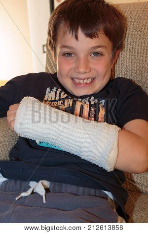 Eight Years Old Child Keeps Broken Arm in Gypsum
