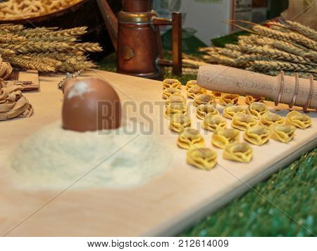 Tortellini Italian Pasta, Cutter Rolling Pin, Sheaves of Wheat and Egg on Flour