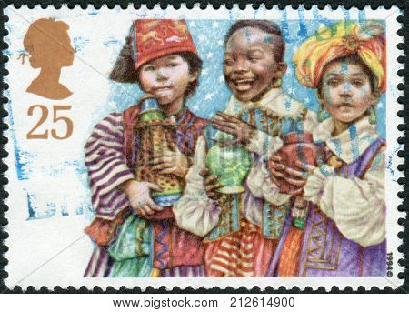 UNITED KINGDOM - CIRCA 1994: Postage stamp printed in England Christmas Issue shows a Children's Nativity Plays Three Wise Men circa 1994