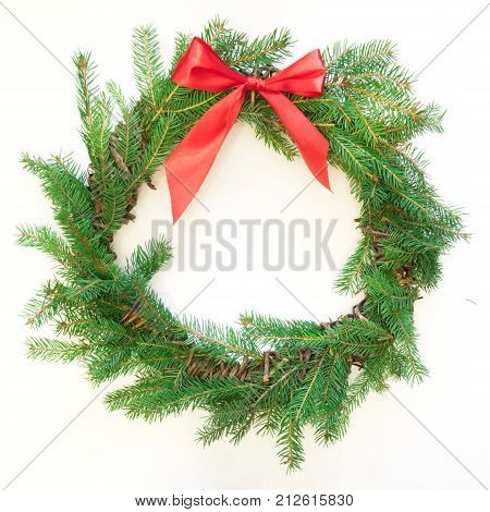 Christmas Fresh Natural Wreath From Spruce Branch With Red Bow On White Background. Square Image.