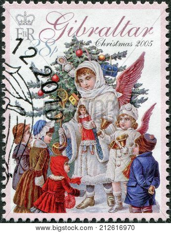 GIBRALTAR - CIRCA 2005: A stamp printed in Gibraltar, is devoted to Christmas, shows an angel, a Christmas tree and children, circa 2005