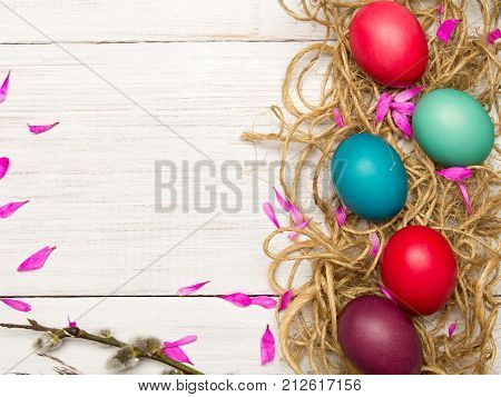 Easter background with colorful egg and catkins copy space
