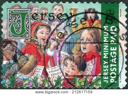 JERSEY - CIRCA 2001: Postage stamp printed in Jersey (Crown dependencies of the British Crown) Christmas Issue shows children sing Christmas songs circa 2001