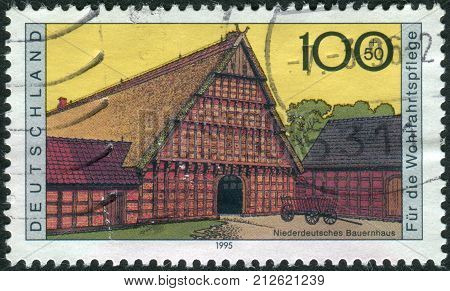 GERMANY - CIRCA 1995: Postage stamp printed in Germany shows a Farmhouses Lower Germany circa 1995