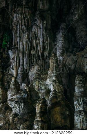 Limestone stalactites in Adygeya underground cave, speleology grotto concept
