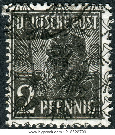 GERMANY - CIRCA 1947: Postage stamp printed in Germany (overpint Type B: US and British occupation zone) shows the Planting Olive circa 1947